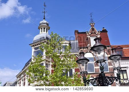 Lovely, historic house facade with turret and blue sky.