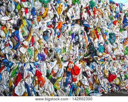 Crushed and packaged plastic bottles in a recycling center