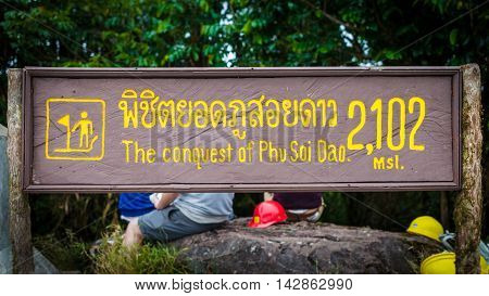Sign of conquest 2102 mls. Phu Soi Dao National Park in uttaradit, Thailand