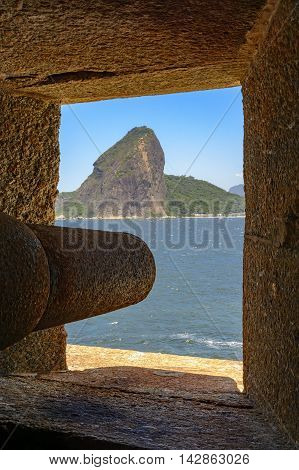 Cannon at the Fortress of Santa Cruz directed to the Guanabara Bay entrance and responsible for the defense of Rio de Janeiro at the time of the empire. You can see the Sugar Loaf hill in the background.