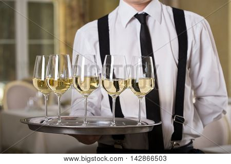 glasses of wine on a tray Sommelier