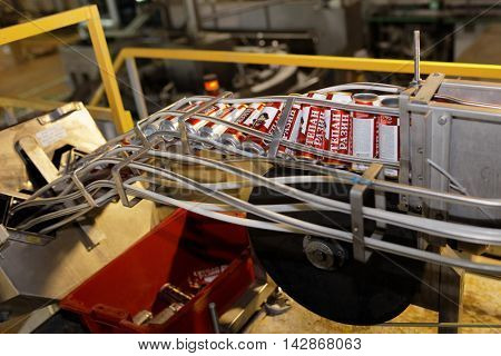 ST. PETERSBURG, RUSSIA - AUGUST 11, 2016: Beer conveyor in the Heineken brewery. In 2003, it was the first Heineken brewery in Russia, and now it can produce over 5 millions HL of beer per year