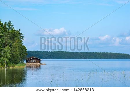 Small summer cottage in shore of lake