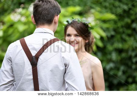 Groomsman with bridesmaid on wedding