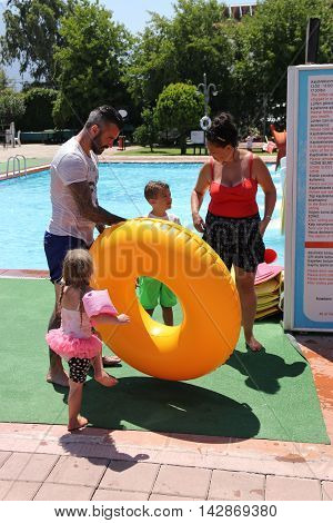 18TH JULY 2016, CALIS,TURKEY: A young english family at an aqua park in Calis in Turkey,18th july 2016