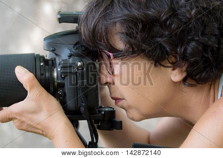 a woman is a professional photographer with slr camera