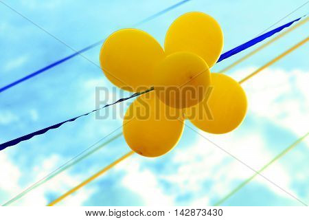 Balloons and ribbons in the colors of Ukrainian flag on the background of blue sky