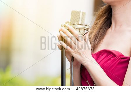 Close-up Of Woman Singing And Performing With Mic In Outdoor