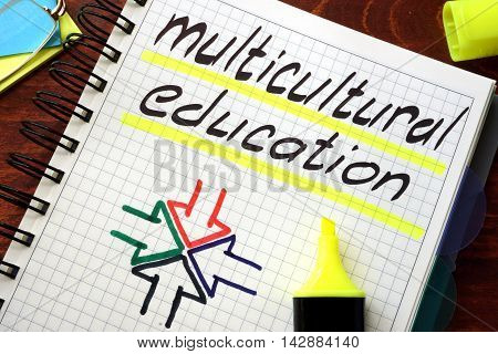 Sign multicultural education written in a notepad on a table.