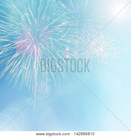 Colorful fireworks on blue bokeh background with lens flare. Abstract New Year holiday or party background