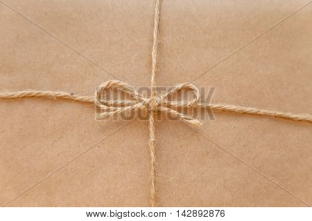 Vintage package tied up with string macro close up