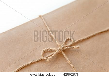 Elemetn of Vintage package tied up with string isolated on a white background