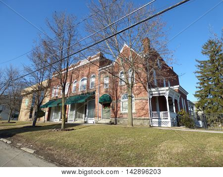 Historic Cunningham three section brick complex building in Greene NY