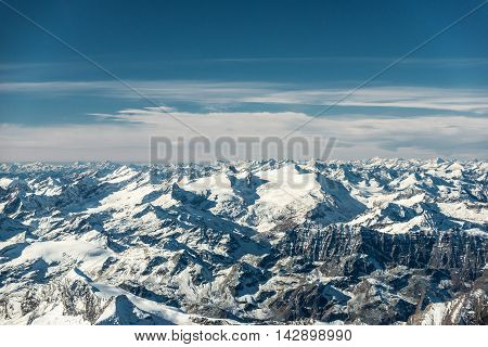 over the mountain peaks covered with snow at winter in austrian alps