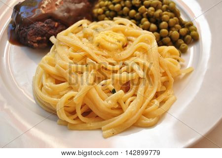 Fresh Linguini Pasta Served as a Side Dish with Garlic Butter