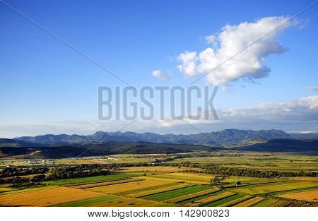 Cultivated land in a rural landscape, at sunset light