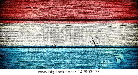 flag of Luxembourg painted on old grungy wooden background: 3d illustration
