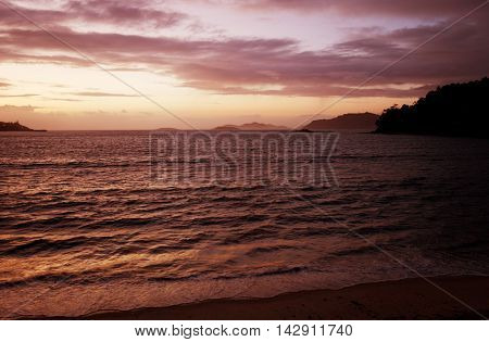 sunset from the beach of Baiona, Galicia, Spain. View of the Cies islands