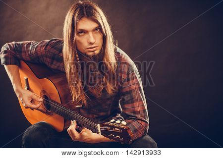 Young Musican Practicing With Guitar.