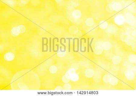 Abstract yellow background with white bokeh and patches of light