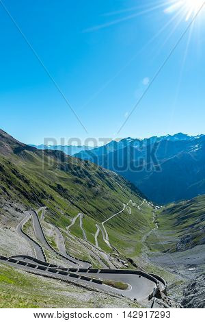 Beautiful sunset about famous road in mountains Alps Passo Stelvio