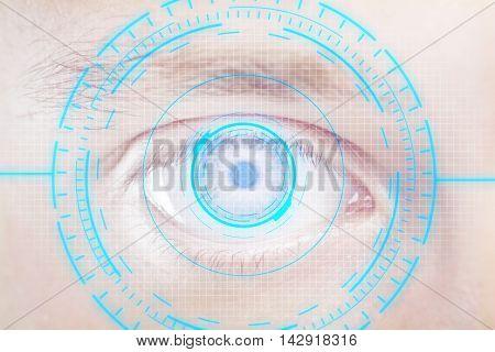 Closeup of human eye with digital blue interface