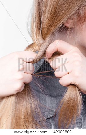 Blonde Woman Making Braid Tress.