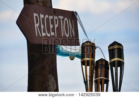Reception sign, snorkel mask and torches on Perhentian island, Malaysia