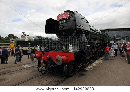 Shildon, County Durham - July 31: The Flying Scotsman draws crowds as it visits Shildon Railway Museum for nine days in July, July 31, 2016 in Shildon, County Durham