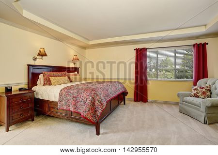 Bedroom Interior With Deep Brown Furniture And Red Curtains.