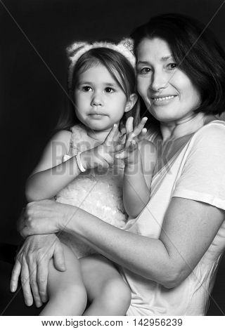 Portrait of a grandmother with her granddaughter, happy together