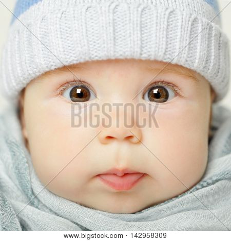 Little beautiful baby with brown eyes cute face closeup