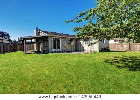 Backyard Garden With Cage. Rambler House Exterior