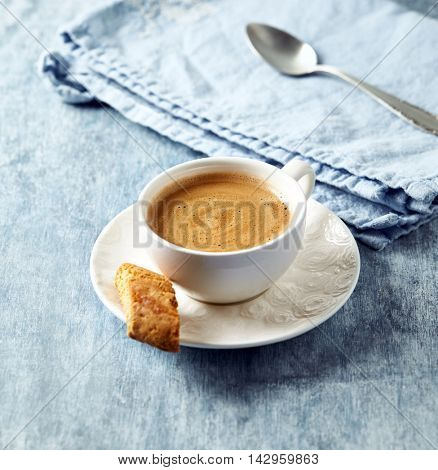 Cup of Cafe Crema with a Cantuccini Cookie