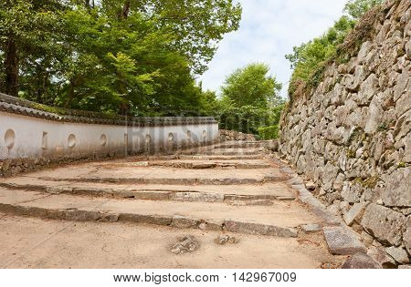 TAKAHASHI JAPAN - JULY 20 2016: Earthen white walls (hei) and stonewalls (ishigaki) of Bitchu Matsuyama castle (17th c.) Takahashi Japan. Matsuyama is one of only 12 survived castles in Japan