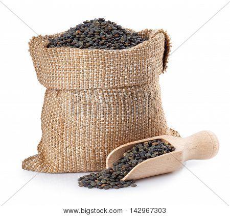 black beluga lentils in burlap bag with wooden scoop isolated on white background. Black beluga lentils. Super food