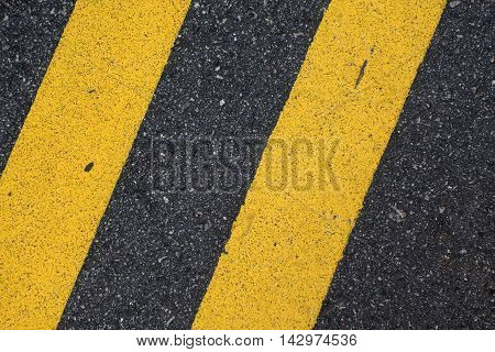 Black Road Pavement with Yellow Double Line