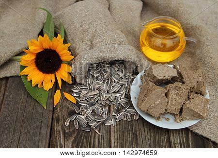 Sunflower, sunflower seeds, oil and sweets on stoly in a garden