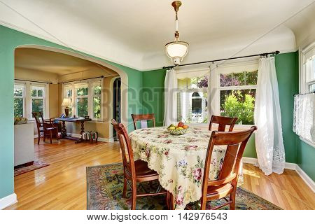 Traditional Dining Area With Wooden Table Set. Open Floor Plan.