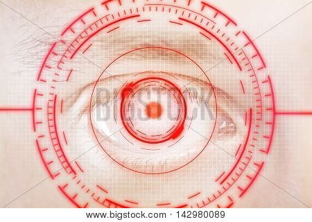 Closeup of human eye with digital red interface