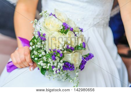 Beautiful wedding bouquet in bride's hand. A bride is holding a bouquet.