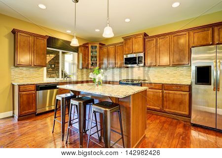 Wooden Kitchen Interior With Kitchen Island And Cabinets.