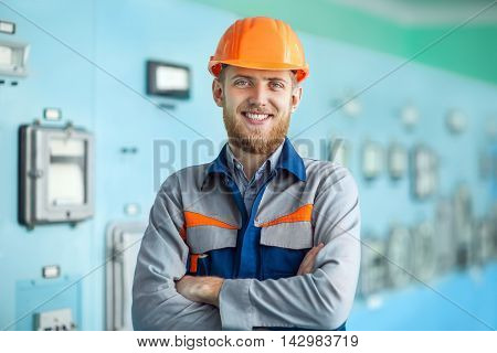 Portrait Of Young Happy Engineer At Control Room