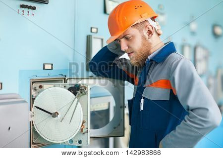 Young Engineer Repairing Equipment At Control Room