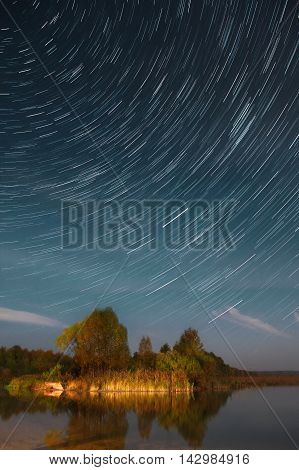 A long exposure of the sky with the star trails over the Lake Pleshcheyevo in Yaroslavl Oblast Russia