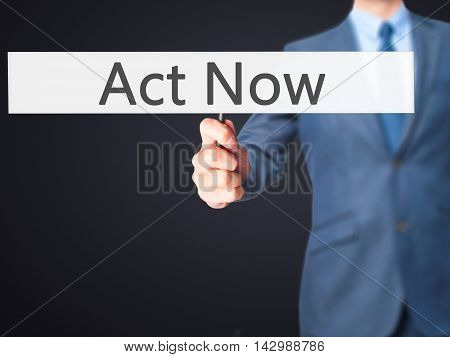 Act Now - Business Man Showing Sign