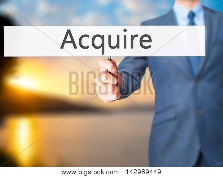 Acquire - Business Man Showing Sign