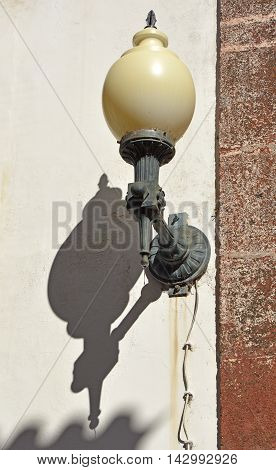Electric lamp on wall in street Funchal Madeira Portugal