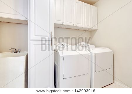 White Laundry Room With Washer And Dryer.
