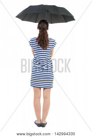 young woman in  dress under an umbrella. Rear view people collection.  backside view of person.  Isolated over white background. Swarthy girl in a checkered dress standing under an umbrella.